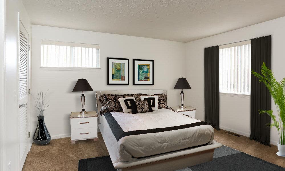 Cozy bedroom at CenterPointe Apartments and Townhomes in Canandaigua