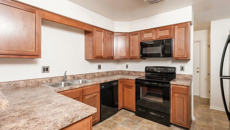 Modern kitchen at CenterPointe Apartments and Townhomes home