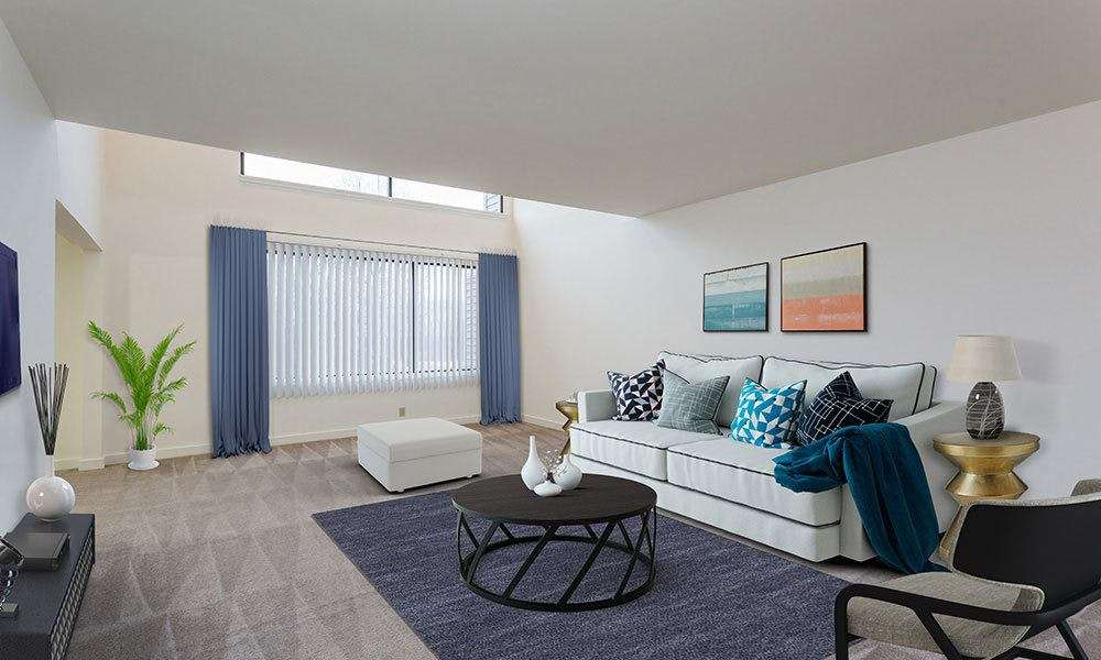 Spacious living room at Emerald Springs Apartments in Painted Post