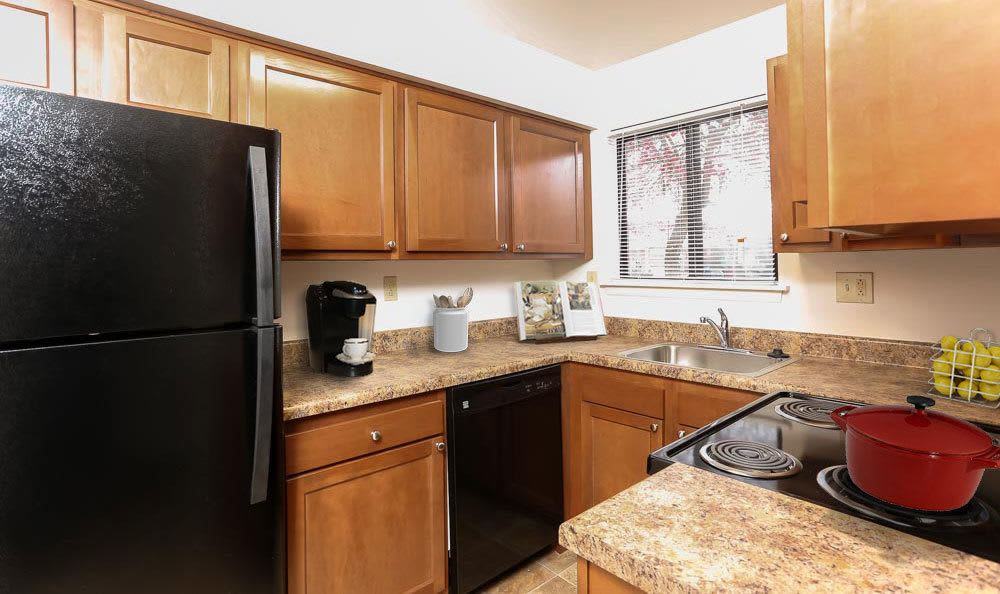 Modern kitchen at Penbrooke Meadows Apartments in Penfield, NY