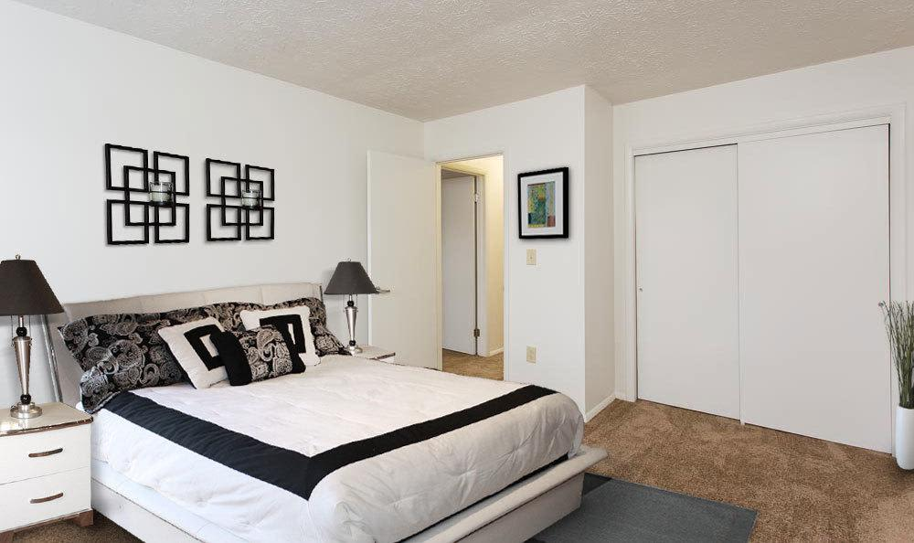 Modern bedroom at apartments in Penfield, NY