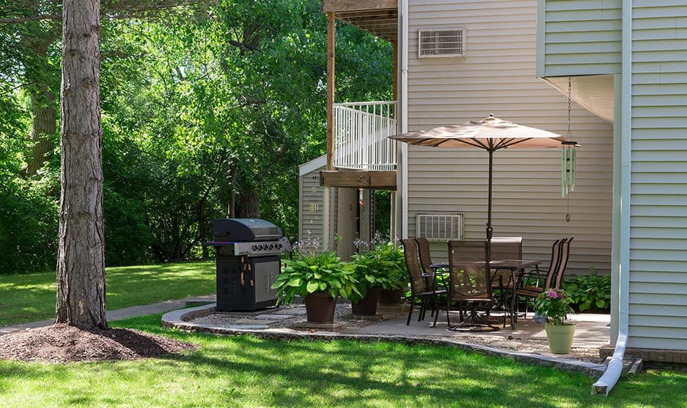 Patio and yard at Penbrooke Meadows Apartments in Penfield, NY