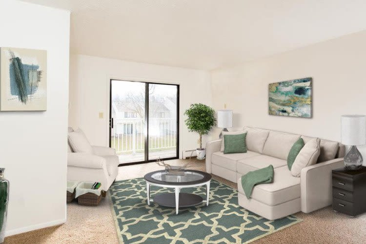 Enjoy a living room at Penbrooke Meadows Apartments in Penfield