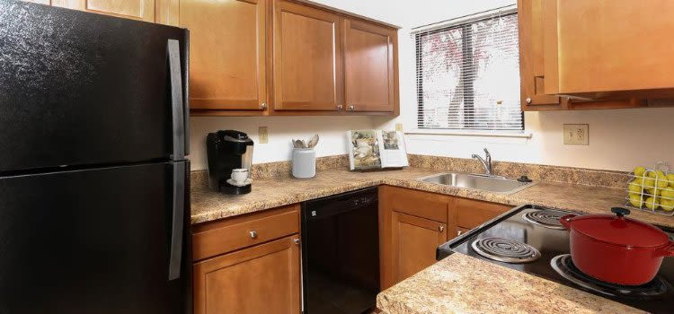 Well-equipped kitchen at Penbrooke Meadows Apartments Penfield, NY