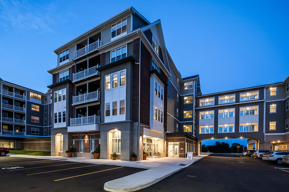 Building Exterior at Pinnacle North Apartments in Canandaigua, NY at dusk