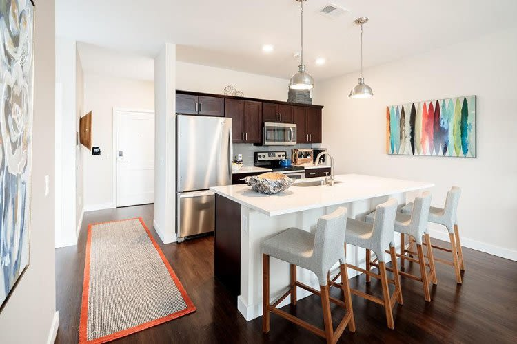 Well-equipped kitchen and breakfast bar at Pinnacle North Apartments home