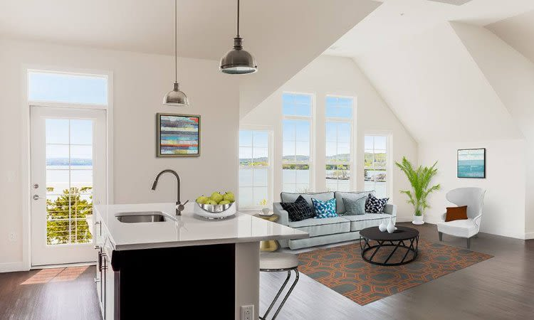 Kitchen island and living room view at Pinnacle North Apartments home