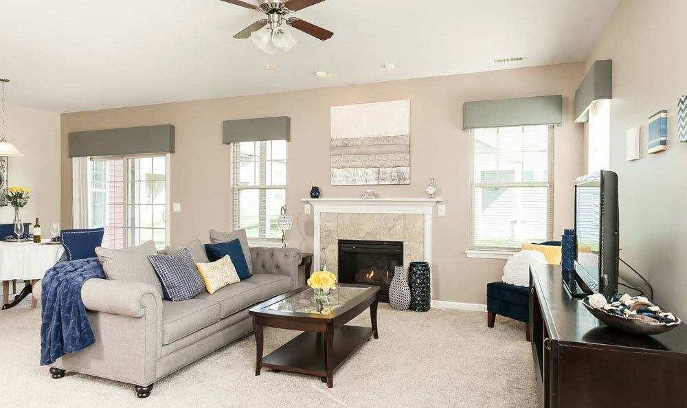 Spacious living room at Saratoga Crossing in Farmington