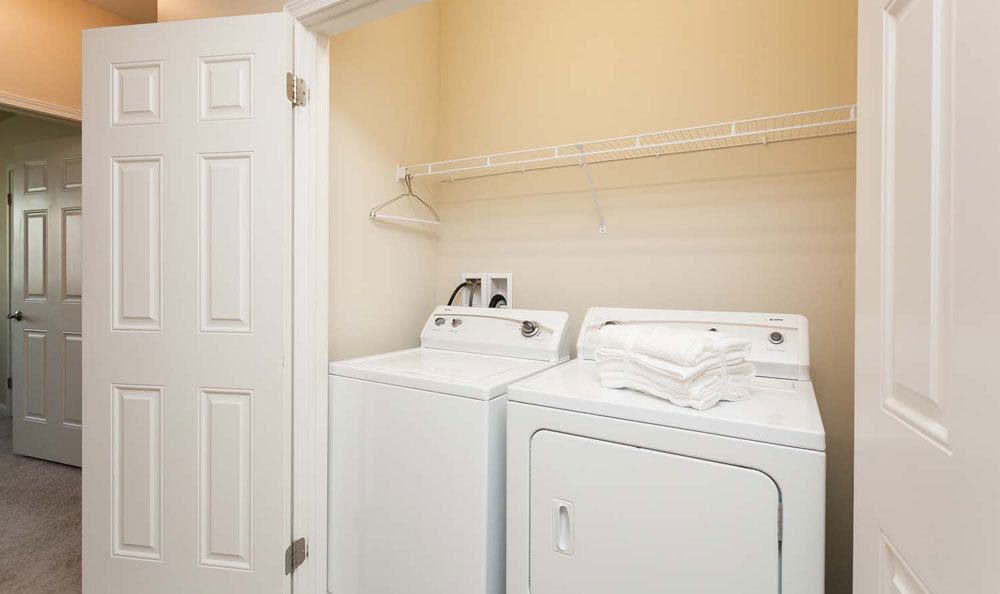 Washer and dryer at Saratoga Crossinghome  in Farmington, NY