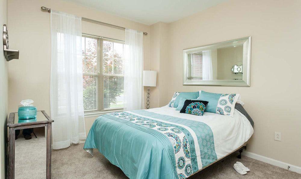 Bedroom at Saratoga Crossing modern apartments