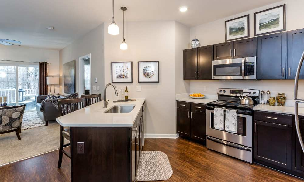 Well-equipped kitchen with island at The Links at CenterPointe Townhomes in Canandaigua