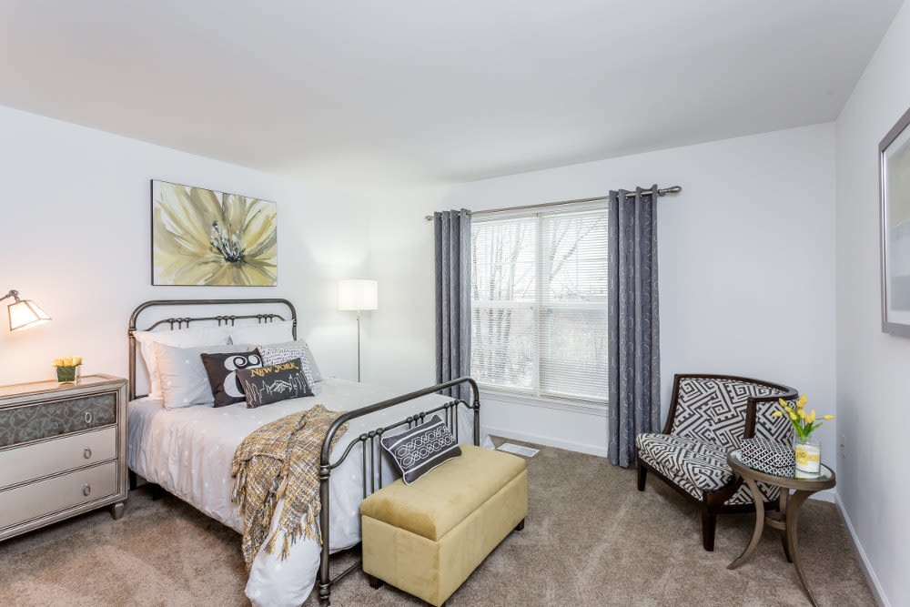 Luxury bedroom at The Links at CenterPointe Townhomes home in Canandaigua, NY