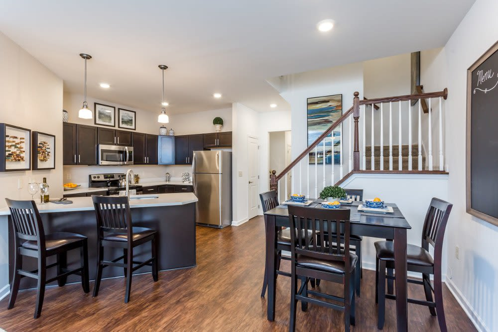 Dining room and kitchen at The Links at CenterPointe Townhomes in Canandaigua, NY