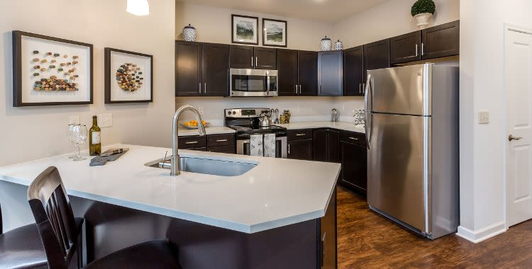 Upgraded kitchen with island at The Links at CenterPointe Townhomes in Canandaigua, NY