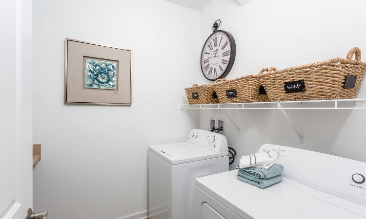 Enjoy apartments at The Links at CenterPointe Townhomes with a washer and dryer