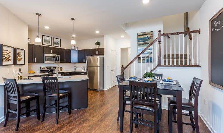 Dining room and kitchen at The Links at CenterPointe Townhomes home