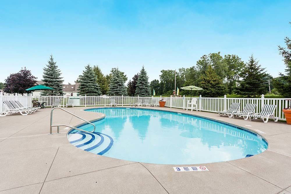 Sparkling pool at Villas of Victor and Regency Townhomes in Victor