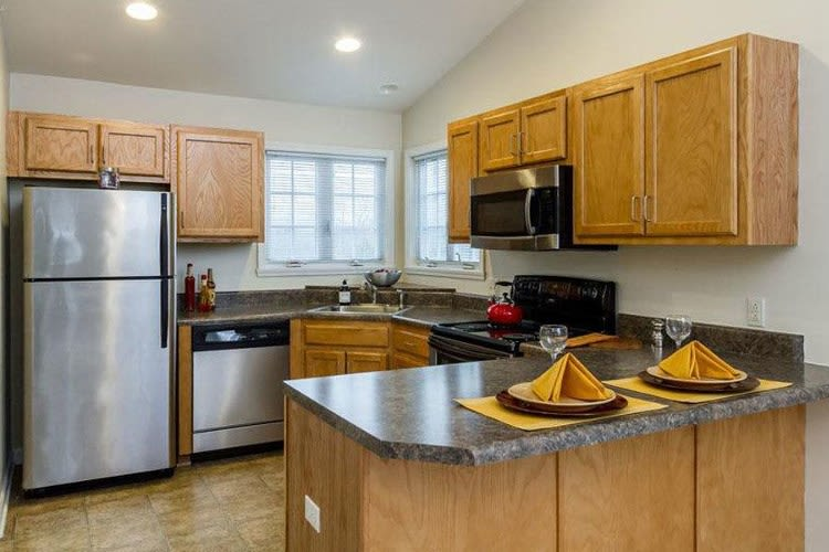 Kitchen with stainless steel appliances at Villas of Victor & Regency Townhomes in Victor, New York