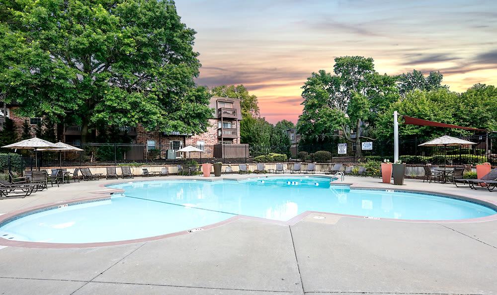 Pool at sunset at London House Apartments
