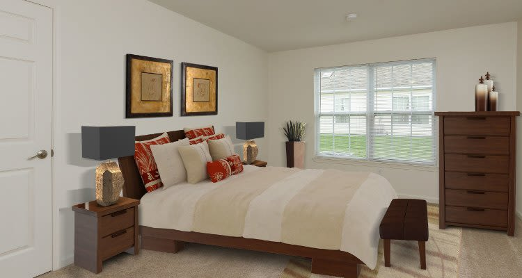 Well decorated bedroom at Villas of Victor & Regency Townhomes home in Victor, New York