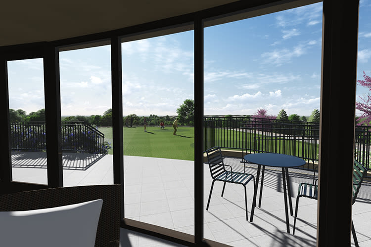 View of outdoor seating on the patio from the on-site restaurant at Resident buildings from the parking lot at The Fairways of Ironhorse in Leawood