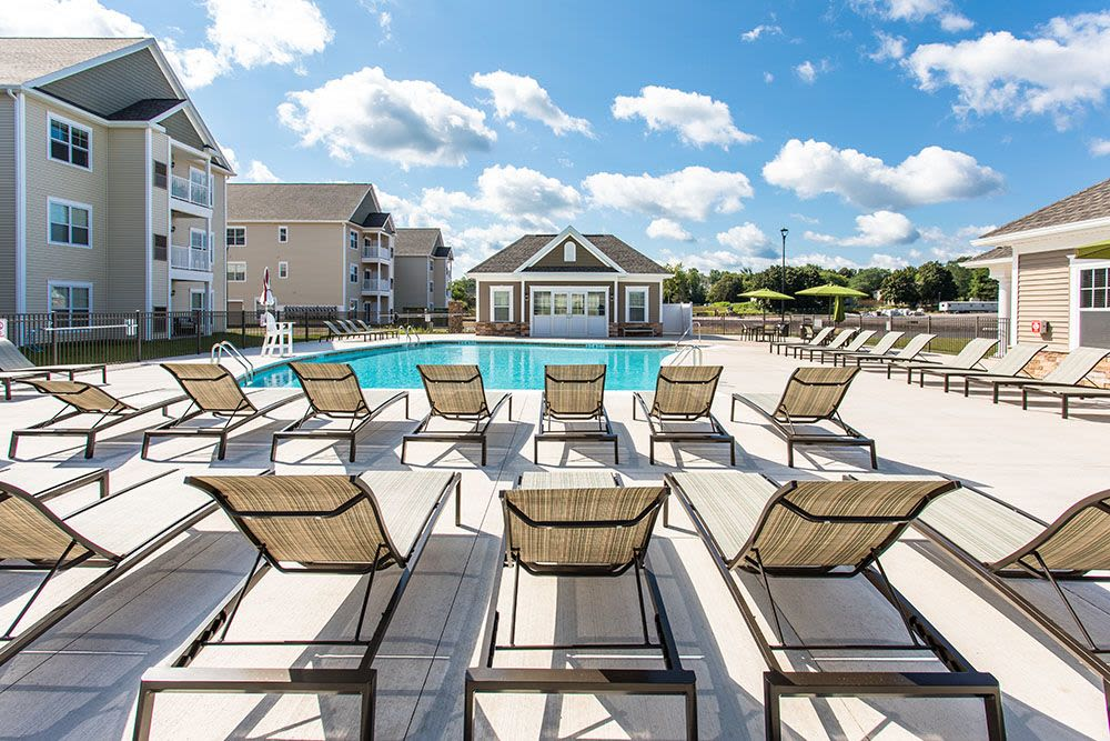Chairs near swimming pool at The Landings at Meadowood in Baldwinsville, New York