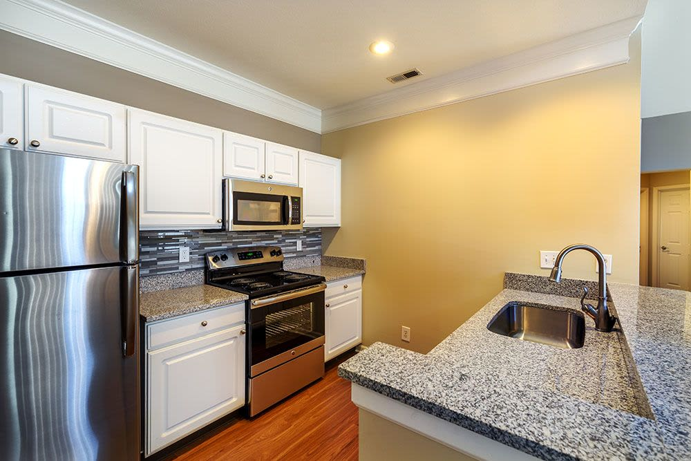 Modern kitchen in model home at Christopher Wren Apartments