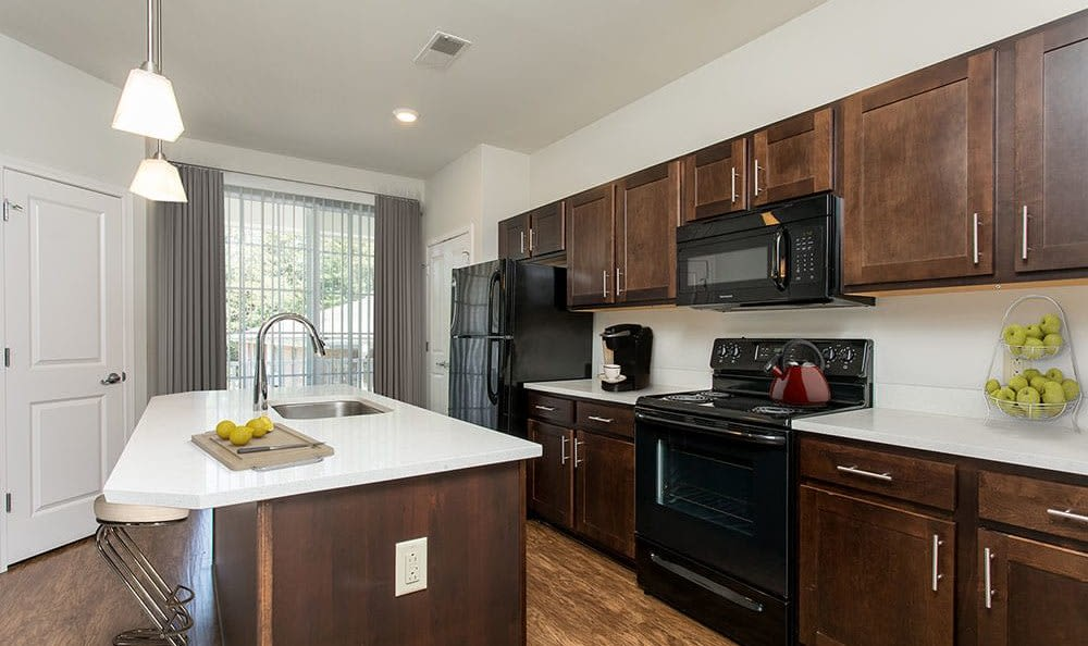 Modern kitchen with island at Green Lake Apartments & Townhomes in Orchard Park, New York