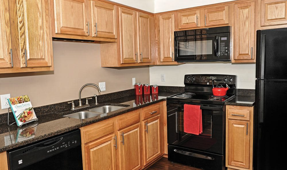 Well-equipped kitchen at Green Lake Apartments in Orchard Park, NY