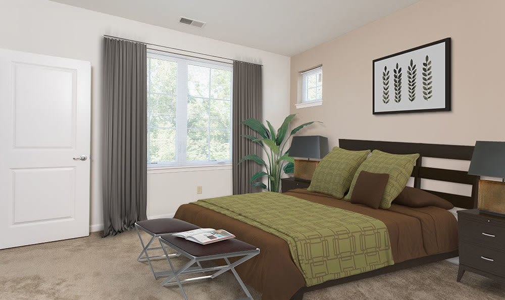 Naturally well-lit bedroom at Green Lake Apartments & Townhomes in Orchard Park, New York