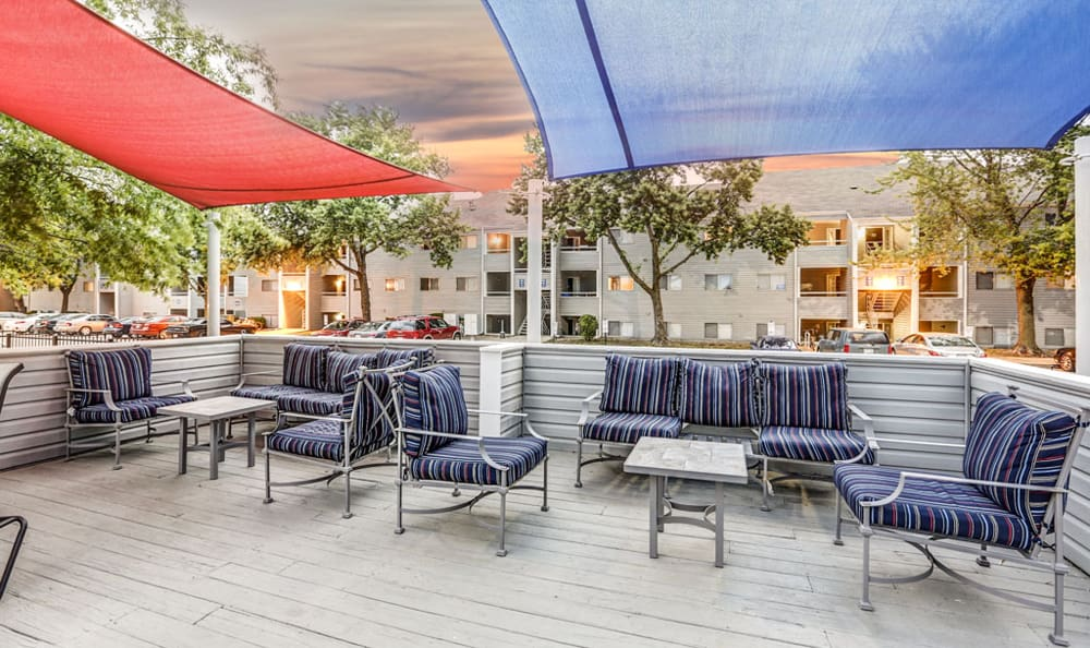 Outdoor seating at sunset at Orchard Corners Apartments