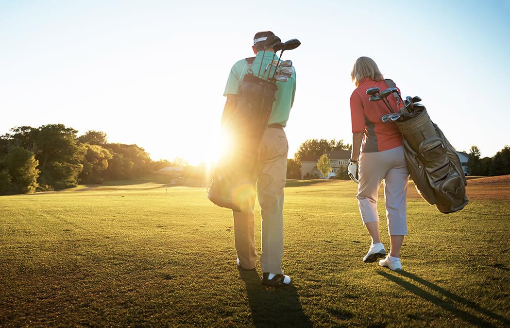 Residents of The Fairways of Ironhorse golfing at sunset