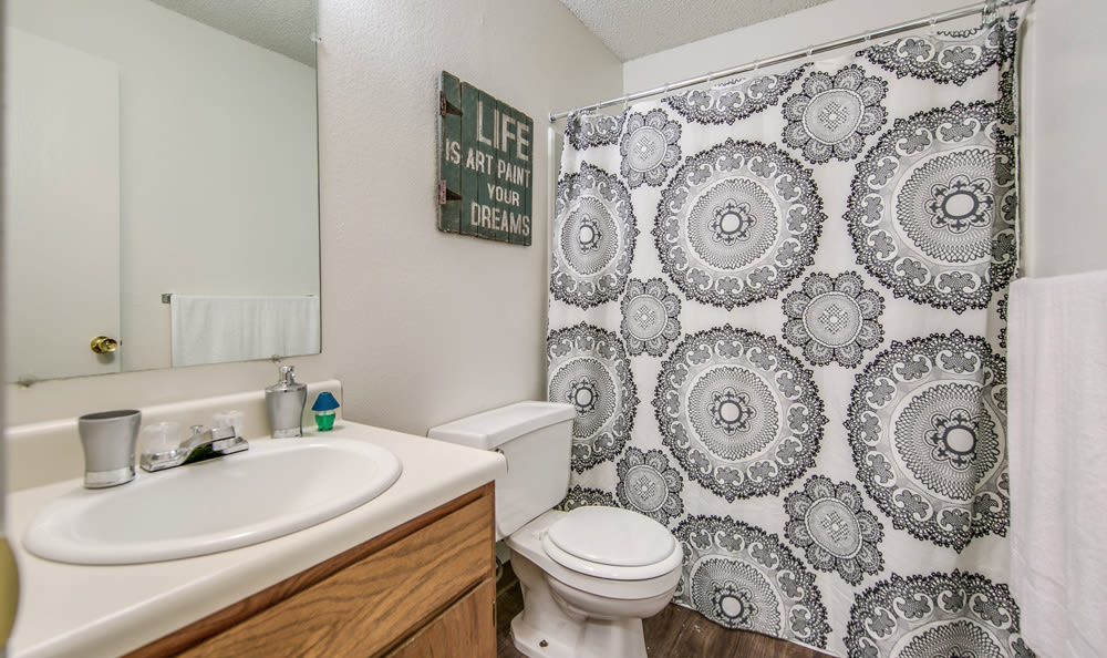 Bathroom with shower at Orchard Corners Apartments