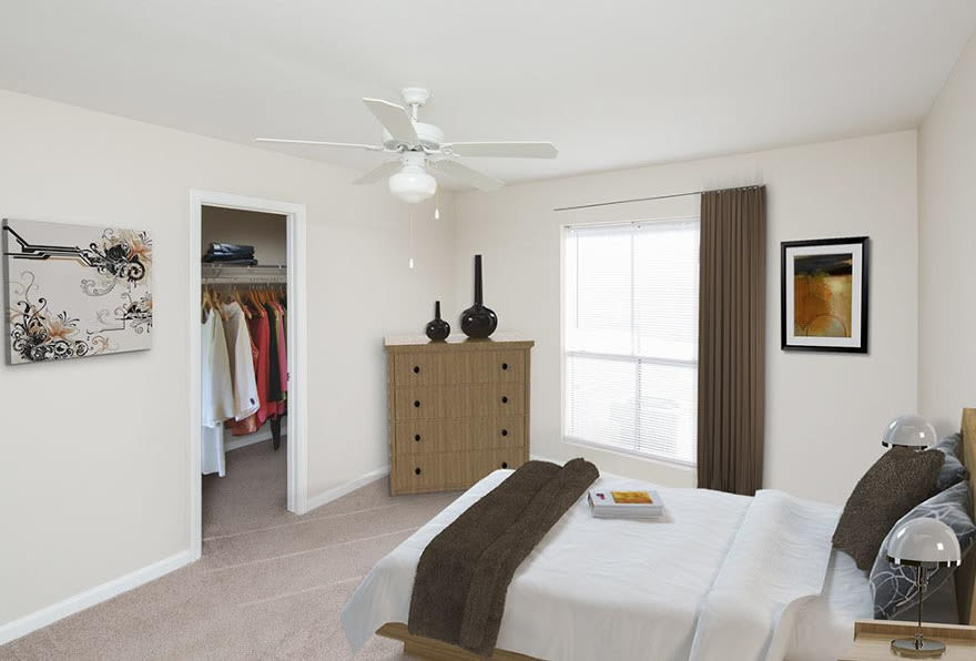 The bedrooms are clean and cozy at Morgan Bay in Houston, TX
