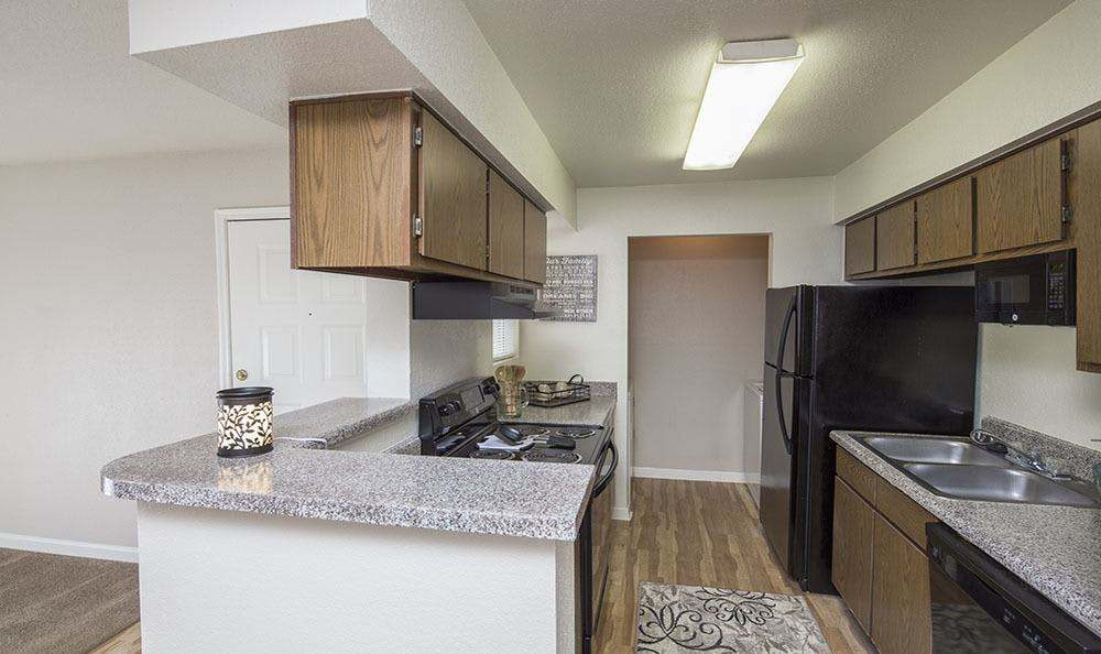 Well-equipped kitchen at Stone Ridge Apartments in Texas City