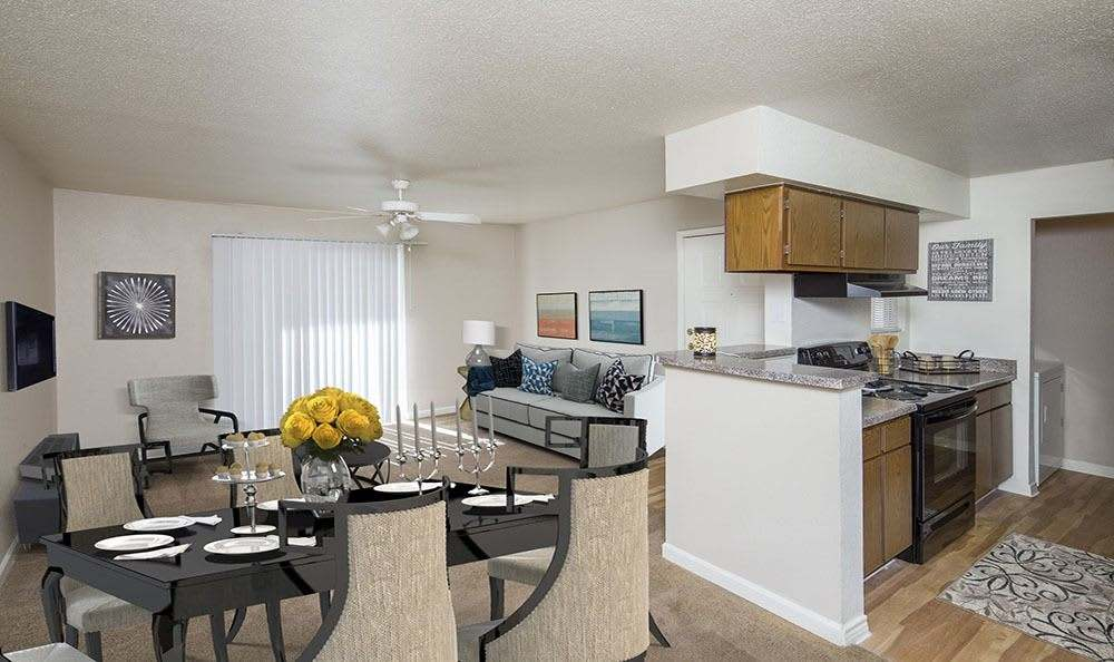 Dining table, kitchend and living room view at Stone Ridge Apartments in Texas City