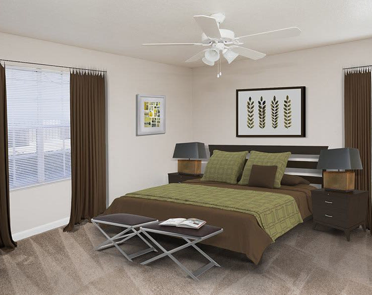 Stone Ridge Apartments offers a cozy bedroom in Texas City, TX