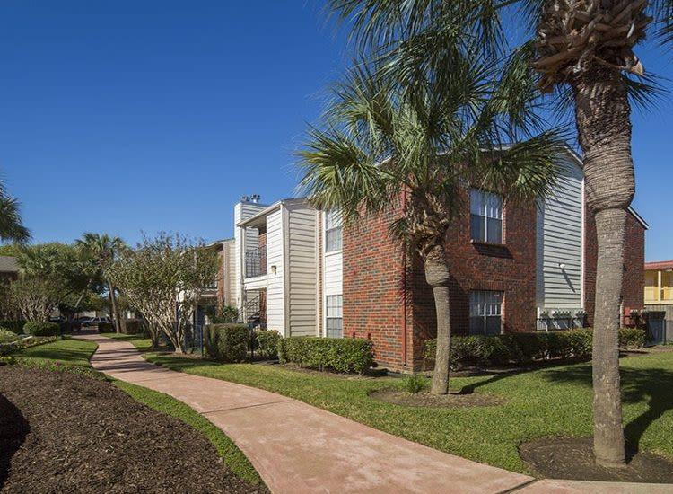 Apartments and walking path at Stone Ridge Apartments in Texas City, TX