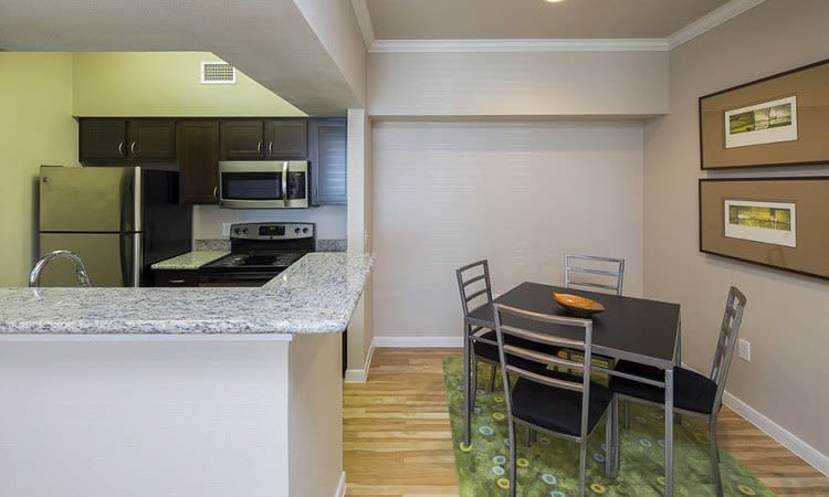 Kitchen and dining table at Veranda apartment in Texas City, TX