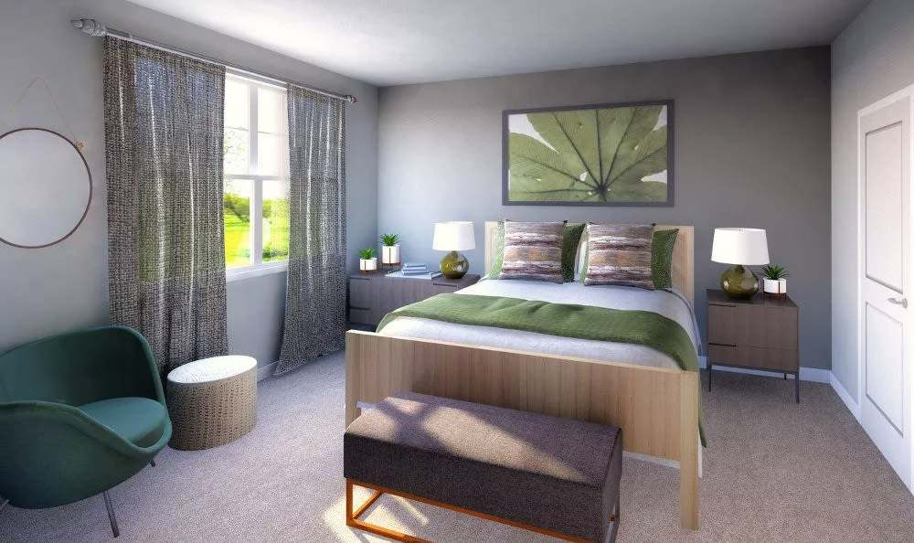 Naturally well-lit bedroom at Woodland Acres Townhomes in Liverpool
