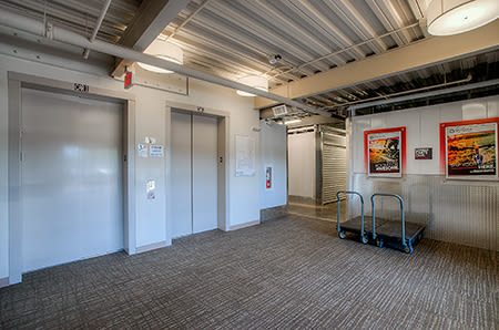 Interior view of elevators and complimentary dollies for your use moving in or out of StorQuest Self Storage in Scottsdale