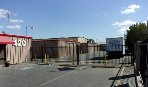 Gated entrance at StorQuest Self Storage in Los Banos, CA