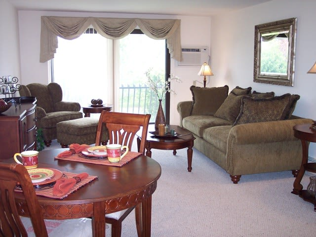 Village Green Apartments offer a cozy living and dining room in Baldwinsville