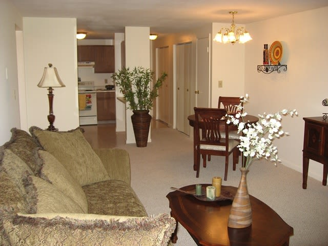 Living room at Village Green Apartments in Baldwinsville, NY