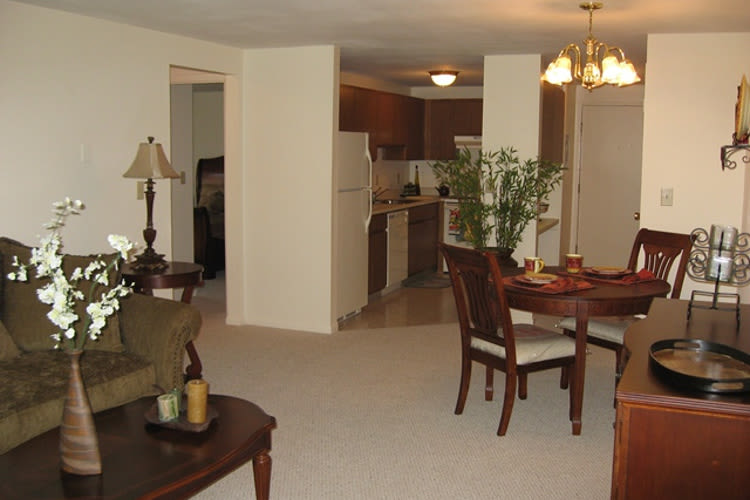 Kitchen and dining room view at Village Green Apartments in Baldwinsville