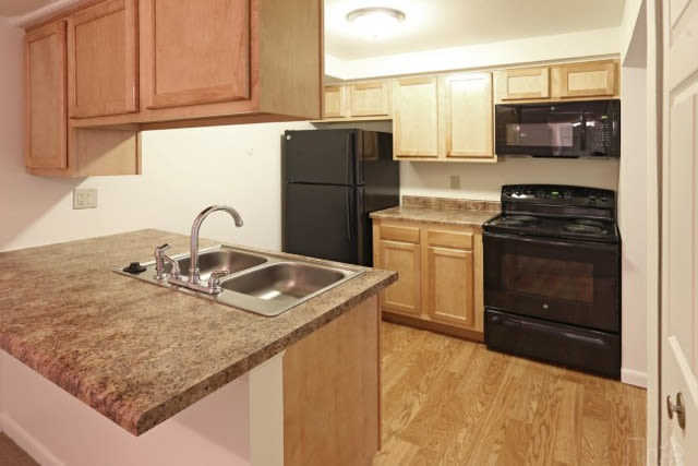Well-equipped kitchen at Westminster Place Apartments in Liverpool, NY