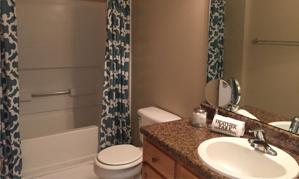Spacious bathroom at Heather Park Apartment Homes in Garner, NC