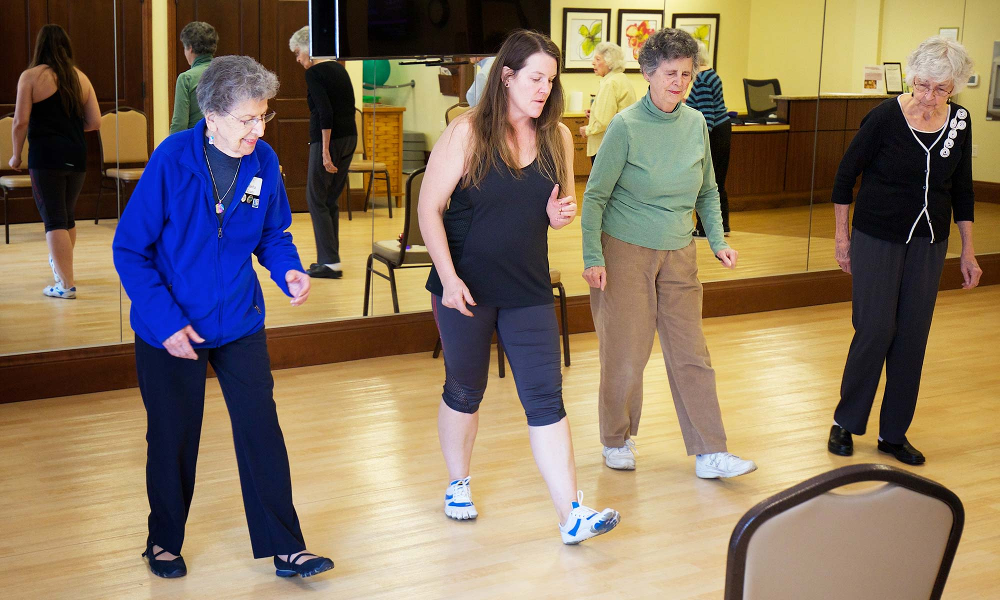 Residents of Clermont Park taking a dancing class