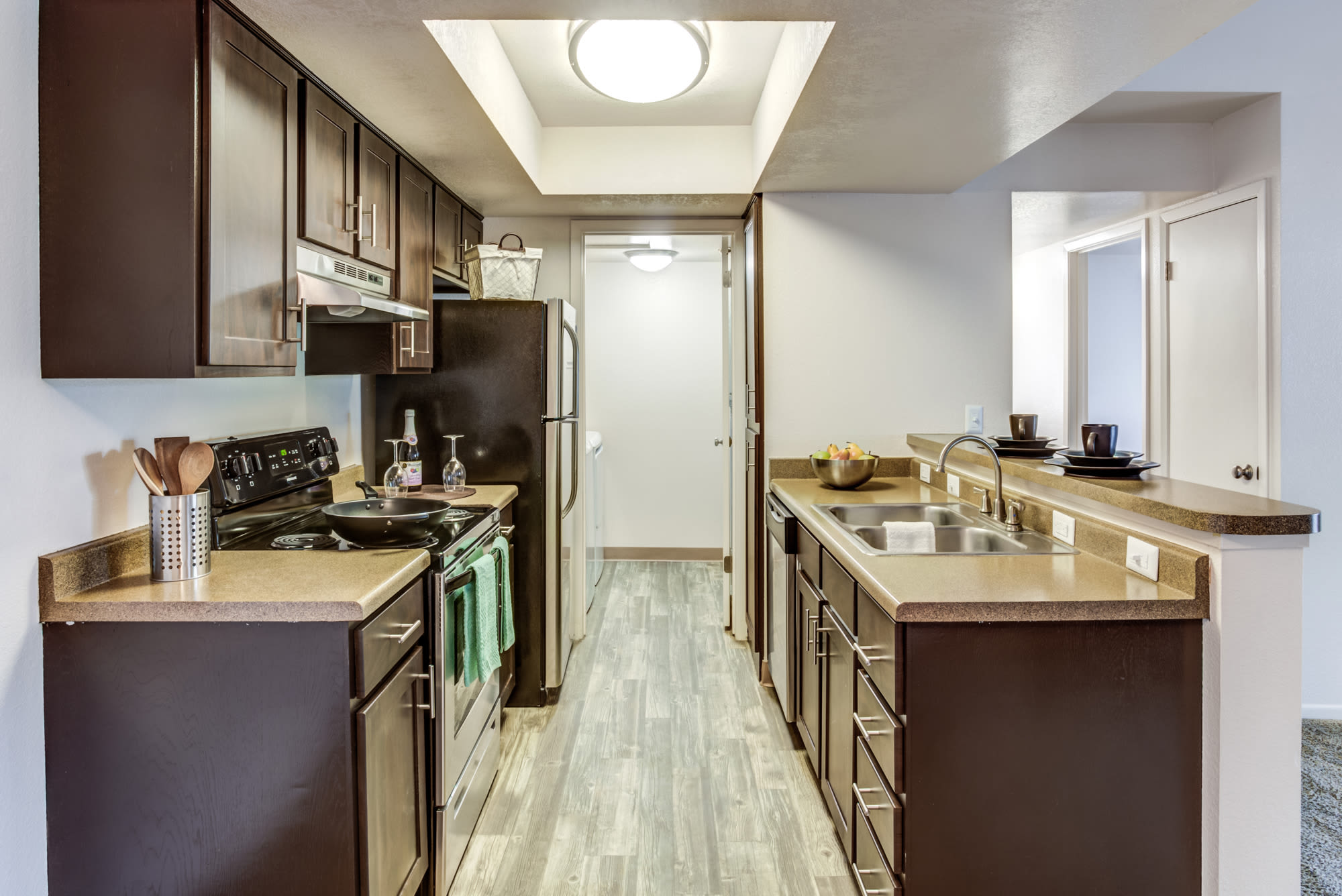Kitchen at Springs of Country Woods Apartments in Midvale