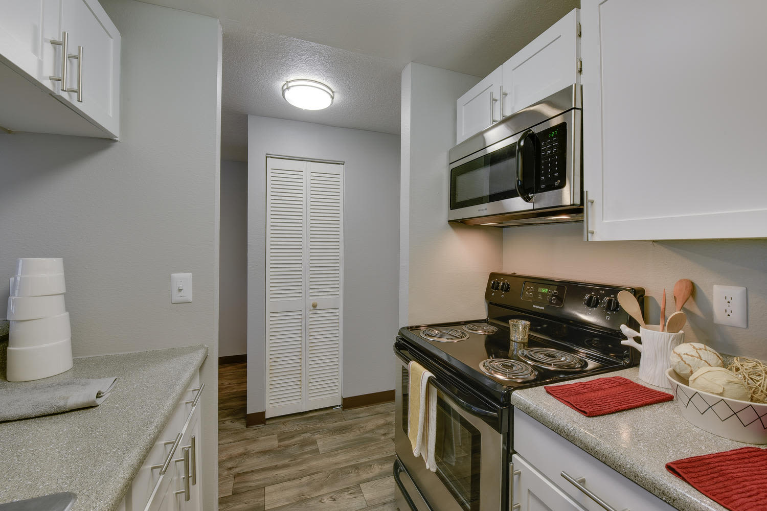 Kitchen and Living Room at Arbor Creek Apartments in Beaverton